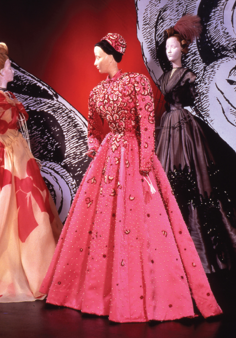 Balenciaga. Raspberry Satin (synthetic) long evening dress with tiny  collar, long narrow sleeves, and full skirt. Embroidery of pearls and ruby  beads.